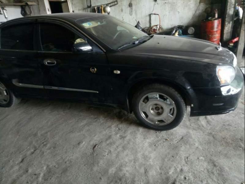 Xe Daewoo Magnus AT năm sản xuất 2004, màu đen, xe nhập