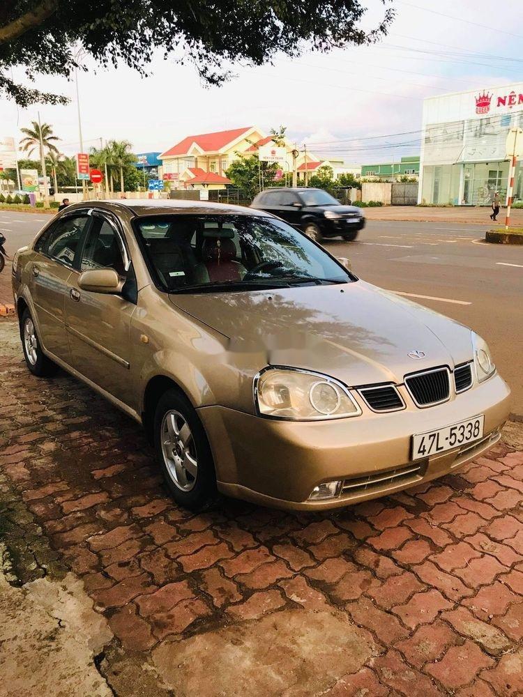 Bán Daewoo Lacetti năm sản xuất 2005, màu vàng cát